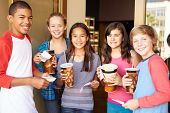pic of pre-adolescent child  - Group Of Children Standing Outside Cinema Together - JPG