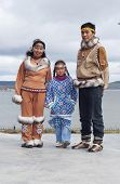 foto of chukotka  - Chukchi family in folk dress at the landscape background - JPG