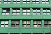 foto of fragmentation  - green city building front view fragment with square windows - JPG
