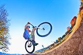 image of dirt-bike  - boy going airborne with his dirt bike - JPG