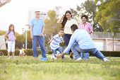 stock photo of 70-year-old  - Multi Generation Family Playing Soccer Together - JPG