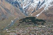 stock photo of greater  - Aerial view on Stepantsminda town in Greater Caucasus Range Georgia - JPG