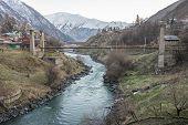 picture of greater  - Bridge over Terek River in Stepantsminda town in Greater Caucasus Range Georgia - JPG