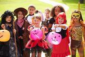 stock photo of fancy-dress  - Children In Fancy Costume Dress Going Trick Or Treating - JPG