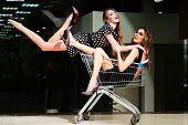 image of black heel  - h two young pretty sexual girls with bright makeup and beautiful slim legs where one in short dress  and black red shoes high heels - JPG