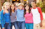 picture of pre-adolescent child  - Group Of Children Hanging Out Together In Mall - JPG