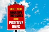 picture of positive negative  - Shift Your Negative Thoughts Into Positive Ones motivational quote written on red road sign isolated over clear blue sky background - JPG