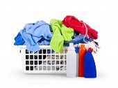 foto of detergent  - Clothes With Detergent And In  Plastic Basket Dropped Isolated On White - JPG