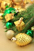stock photo of bump  - Gold bump and Christmas decorations on a spruce branch - JPG