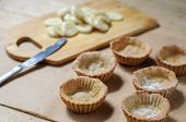 stock photo of whip-hand  - Cooking of little homemade oat tarts with whipped cream - JPG