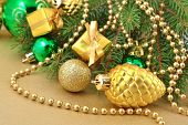 foto of bump  - Gold bump and Christmas decorations on a spruce branch - JPG