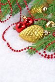picture of bump  - Gold bump and Christmas decorations on a spruce branch - JPG