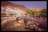 pic of canary  - Small river canal in the Puerto de Mogan, a small fishing port in Gran Canaria ( called the Venice of Canaries ), Canary Islands, Spain