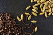 picture of cardamom  - Cardamom and cloves on a black stone - JPG