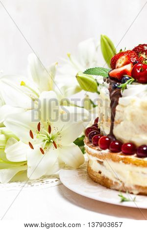 Delicious summer cake with berries and meringue on white wooden background. Homemade cake. Pavlova m