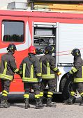 Постер, плакат: Firefighters With Fire Engine Truck