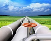 stock photo of aqueduct  - gas pipe line and valve that laid through green field - JPG