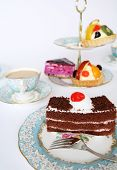image of cake stand  - A slice of chocolate cake tempting the palate at teatime - JPG