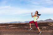 Funny runner athlete goofy woman having fun jogging on outdoor mountain nature trail. Running fitnes poster