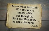 Постер, плакат: Buddha quote on old paper background We are what we think All that we are arises with our thoughts