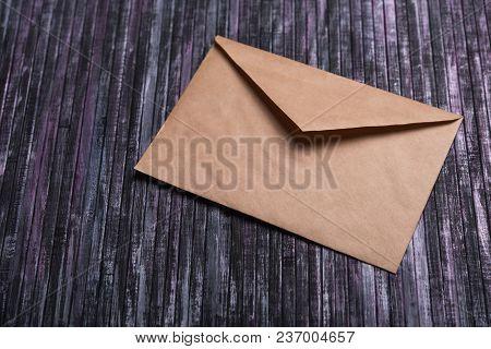 poster of Envelope Of Kraft Paper. Love Letter Envelope. Wooden Background. Social Network.