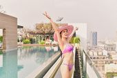 Swimsuit Concept. Beautiful Girl Wearing Pink Swimsuit. Beautiful Girl In Swimwear Is Relaxing At Th poster