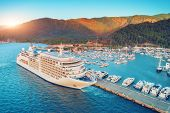 Aerial View Of Beautiful Large White Ship At Sunset poster