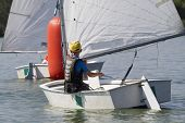 young boy learning to sail