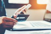 Man Holding Credit Card And Using Cell Phone Holding Credit Card With Shopping Online poster