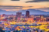 Tucson, Arizona, USA downtown skyline with Sentinel Peak at dusk.  poster