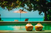 Two Coconut Drinks On Luxury Tropical Beach Resort poster
