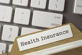 Card File With Health Insurance Overlies Modern Laptop Keyboard. Archive Concept. Closeup View. Sele poster