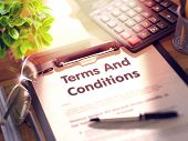 Terms And Conditions- Text On Clipboard With Office Supplies On Desk. 3d Rendering. Toned And Blurre poster