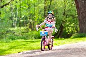 Child On Bike. Kids Ride Bicycle. Girl Cycling. poster