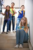 Bullied teenage girl on stairs at school poster