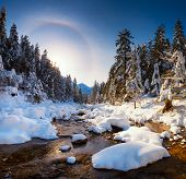 Amazing Spring Landscape. Mountain Stream In Tatra Mountains With Snowy Riverside. Halo Effect In Bl poster
