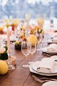 Served Dinner Table In A Restaurant. Restaurant Interior. Cozy Restaurant Table Setting. Defocused B poster