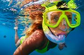 Happy Girl In Snorkeling Mask Dive Underwater With Tropical Fishes In Coral Reef Sea Pool. Travel Li poster