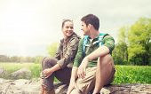 travel, hiking, backpacking, tourism and people concept - smiling couple with backpacks resting and  poster