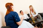 stock photo of married couple  - Young married couple consults at the psychologist - JPG