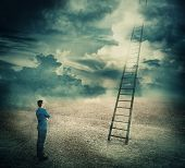Surreal View Of A Businessman Thoughtful Looking At A Huge Ladder Going Up In The Sky Reaching The C poster