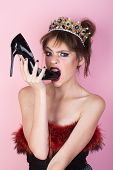 Glamour Style Of Woman Eating Fashionable Shoe. Glamour Woman In Luxury Crown With Stylish Makeup. poster