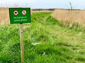 No horses or cycles sign beside a rural footpath in England poster