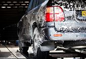 image of suds  - cars in a carwash - JPG