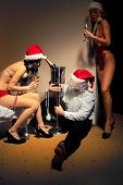 pic of promiscuous  - Santa Claus is Passed out Drunk in company of sexy girls - JPG