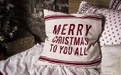 Winter Christmas Decorations. Christmas Cotton Decorative Pillows On A Bed. White Pillows With Title poster
