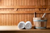 stock photo of sauna  - Detail of bucket and white towels in a sauna - JPG