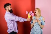 Handsome Bearded Man Gives Bouquet Of Flowers To Woman. Love, Relationship, Dating. Man Giving Bouqu poster