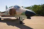 stock photo of f4  - warplane fighter on platform in aircraft museum - JPG