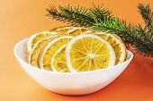 Orange Chips In A White Plate, Near The Spruce Branch, On An Orange Red Background. Eco Organic Home poster
